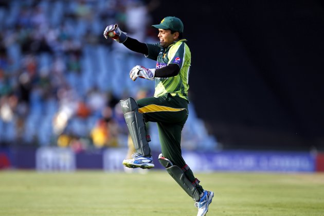 Pakistan's Akmal celebrates making a catch to dismiss South Africa's Abbott during the Twenty20 cricket match at Centurion in Pretoria