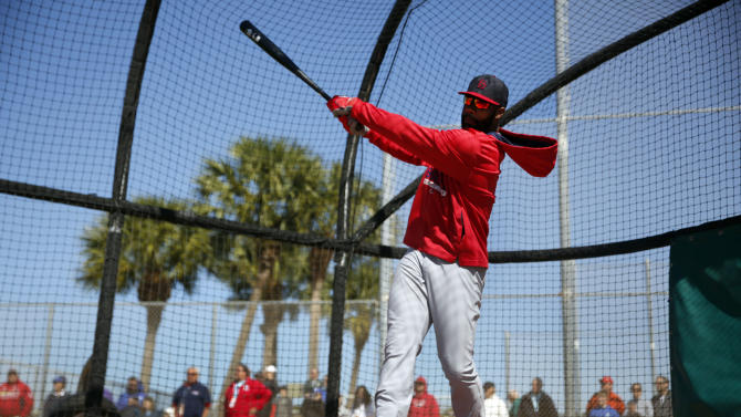 FILE - In this Feb. 20, 2015, file photo, St. Louis Cardinals' Jason Heyward swings in the batting cage during spring training baseball practice in Jupiter, Fla. Heyward could start the season batting second for the St. Louis Cardinals, but he figures to give manager Mike Matheny plenty of lineup options. (AP Photo/Jeff Roberson, File)