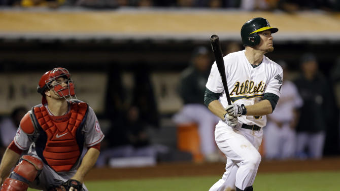 Oakland Athletics' Brandon Moss hits a game winning two-run home run against the Los Angeles Angels during the nineteenth inning of a baseball game on Tuesday, April 30, 2013 in Oakland. Calif. Oakland won 10-8. (AP Photo/Marcio Jose Sanchez)