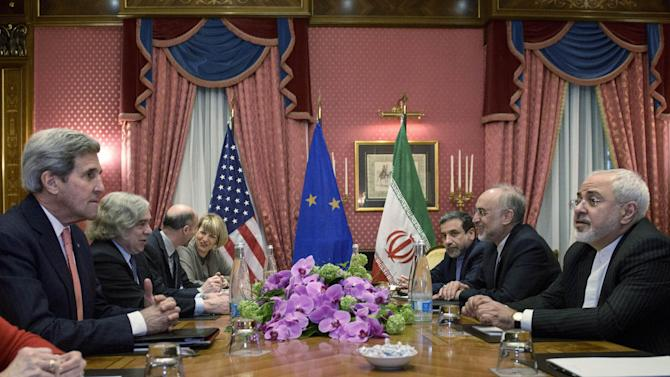 US Secretary of State John Kerry, left, US Secretary of Energy Ernest Moniz, second left, Robert Malley, third left, of the US National Security Council, European Union High Representative Federica Mogherini, fourth left, Head of Iranian Atomic Energy Organization Ali Akbar Salehi, second right, Iranian Foreign Minister Mohammad Javad Zarif, right, and others wait for a meeting on Friday, March 27, 2015 in Lausanne, Switzerland. The Iranian and US officials are in Switzerland to continue negotiations on the Iranian nuclear program. (AP Photo/Brendan Smialowski, Pool)