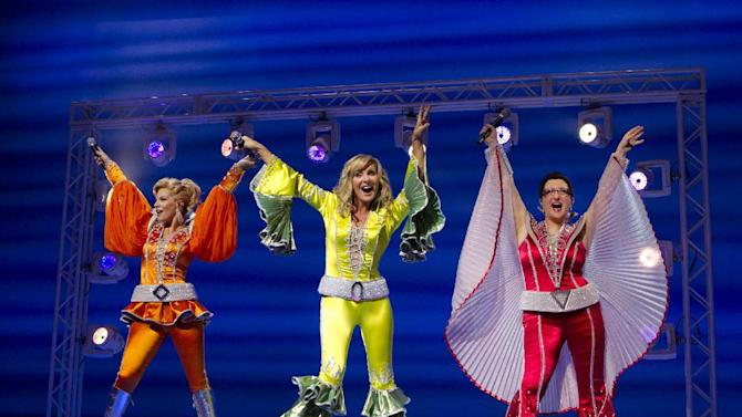 """This theater publicity image released by Boneau/Bryan-Brown shows, from left, Felicia Finley, Judy McLane and Lauren Cohn during a performance of the musical """"Mamma Mia!,"""" at the Winter Garden Theatre in New York. Producers said Thursday, April 18, 2013, that the show featuring sings by ABBA will leave the Winter Garden Theatre and move to the Broadhurst Theatre some six blocks away. (AP Photo/Boneau/Bryan-Brown, Joan Marcus)"""