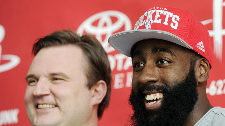 Houston Rockets general manager Daryl Morey, left, and newly acquired guard James Harden pose for photographers at an NBA basketball news conference, Monday, Oct. 29, 2012, in Houston. Morey officially introduced Harden on Monday. Harden joined Houston in a stunning trade with the Oklahoma City Thunder on Saturday night. (AP Photo/Pat Sullivan)