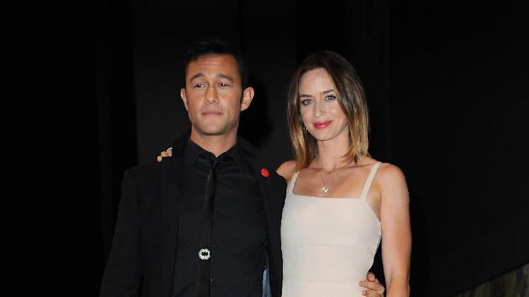 """Joseph Gordon-Levitt and Emily Blunt attend the """"Looper"""" panel at Comic-Con on Friday, July 13, 2012 in San Diego, Calif. (Photo by Jordan Strauss/Invision/AP)"""