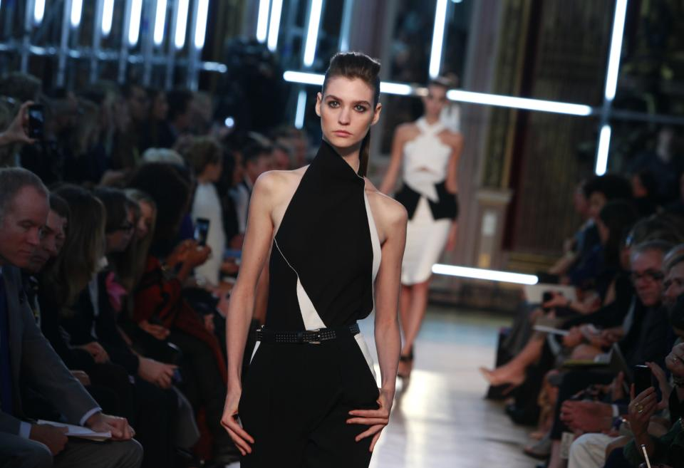 A model wears a creation for French fashion designer Roland Mouret's Spring-Summer 2013 ready to wear  collection, presented in Paris, Friday, Sept.28, 2012. (AP Photo/Thibault Camus)