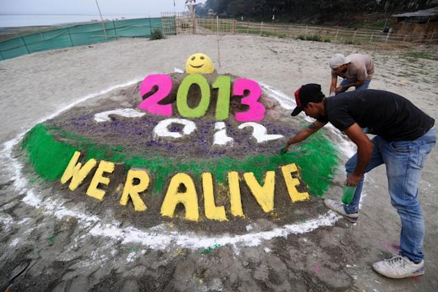 Indian youths make an installation to welcome the new year at the banks of the Brahmaputra river in Guwahati on December 31, 2012. Sydney will kick off a wave of dazzling firework displays welcoming i