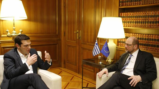 Greek Prime Minister Alexis Tsipras and European Parliament President Martin Schulz talk at the Greek Premier's office in Athens