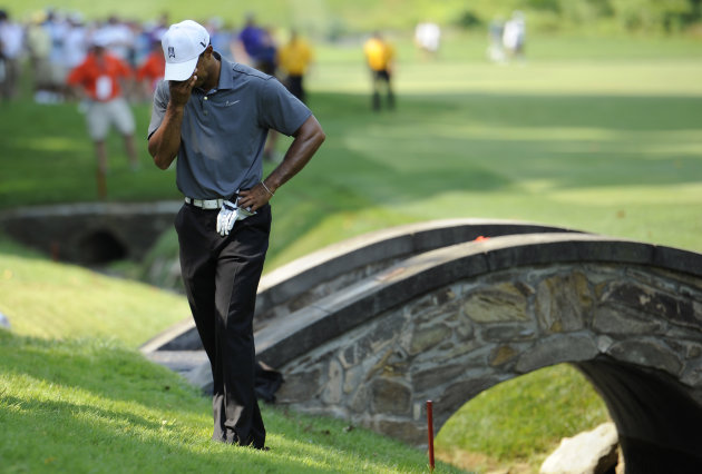 Tiger Woods pauses as he waits to hit out of the rough on the 11th hole during the first round of the AT&T National golf tournament at Congressional Country Club in Bethesda, Md., Thursday, June 28, 2012. (AP Photo/Nick Wass)