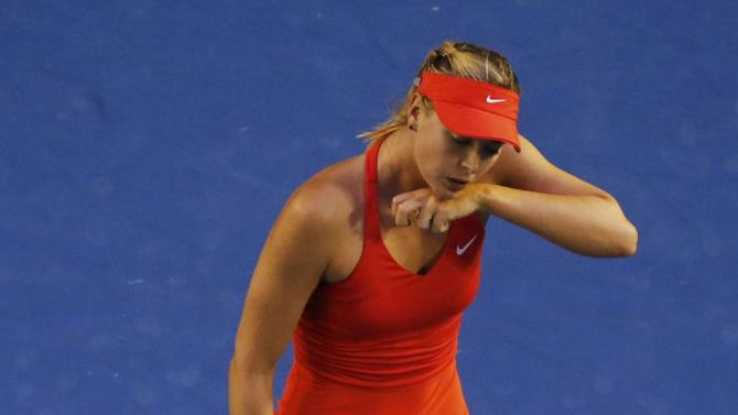 Sharapova of Russia reacts after losing a point to Williams of the U.S. during their women's singles final match at the Australian Open 2015 tennis tournament in Melbourne