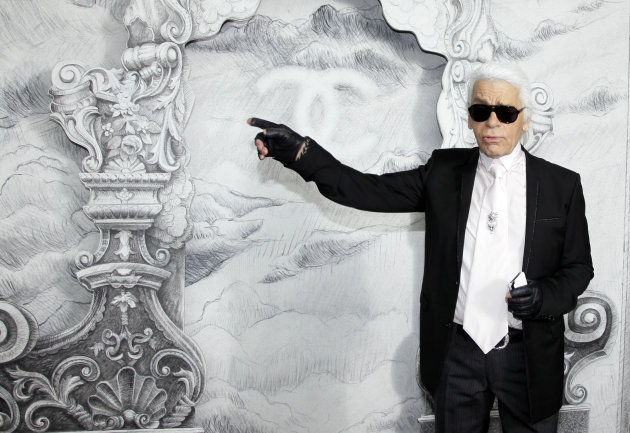 Fashion designer Karl Lagerfeld for Chanel arrives for his Women's Fall Winter 2013 haute couture fashion collection in Paris, France, Tuesday, July 3, 2012. (AP Photo/Francois Mori)
