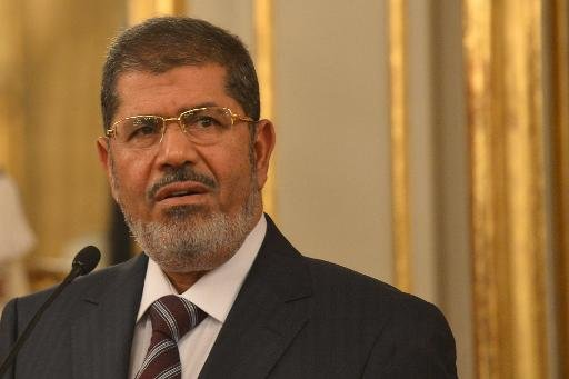 Egypt President Mohamed Morsi speaks during a press conference on September 14, 2012 in Rome