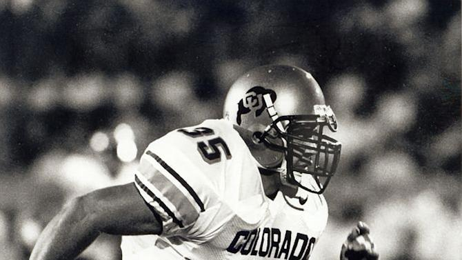 """In this undated photo provided by the University of Colorado, Keith Miller rushes down the field as a fullback for the NCAA college football team. Miller has reinvented himself, going from the gridiron to the stage and will appear in Verdi's """"Un Ballo in Maschera,"""" at the Metropolitan Opera in New York. Performances begin Thursday, Nov. 8, 2012. (AP Photo/University of Colorado)"""