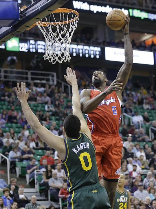 Utah Jazz's Enes Kanter (0) defends against Los Angeles Clippers' DeAndre Jordan (6) in the first quarter during an NBA basketball game on Friday, March 14, 2014, in Salt Lake City