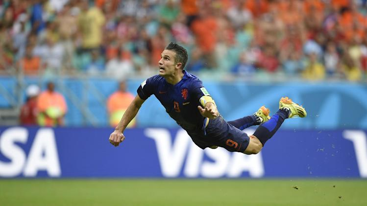 Netherlands' forward Robin van Persie scores during the World Cup match against Spain in Salvador on June 13, 2014