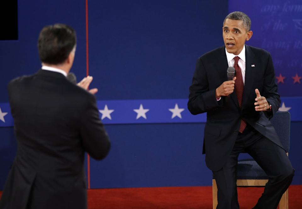 Republican presidential nominee Mitt Romney and President Barack Obama speak during the second presidential debate at Hofstra University, Tuesday, Oct. 16, 2012, in Hempstead, N.Y. (AP Photo/David Goldman)