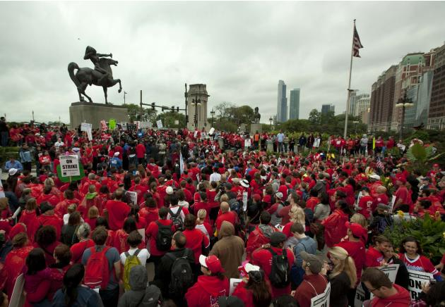 A large crowd of public school teachers  rally at Chicago's Congress Plaza to protest against billionaire Hyatt Hotel mogul Penny Pritzker, who is also a member of the Chicago Board of Education on Th