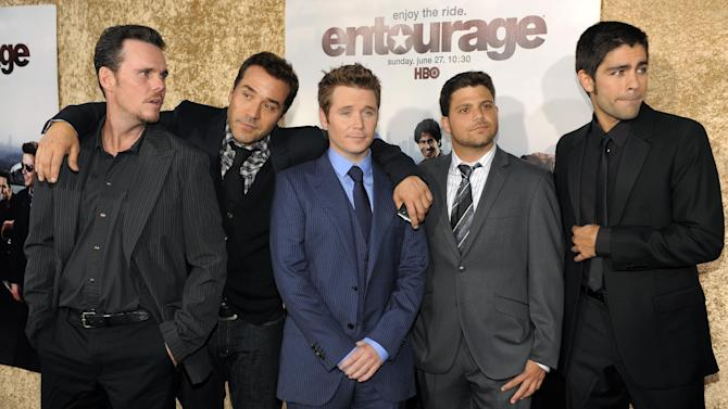 """FILE - This June 16, 2010 file photo shows """"Entourage"""" cast members, from left, Kevin Dillon, Jeremy Piven, Kevin Connolly, Jerry Ferrara and Adrian Grenier pose together at the premiere of the seventh season of the HBO series in Los Angeles. The long-planned """"Entourage"""" movie is finally """"a go,"""" says series creator Doug Ellin. Ellin tweeted the news Monday, Oct. 28, 2013, along with a photo of himself and the cast arm-in-arm. Returning to bring the HBO series to the big screen are stars Jeremy Piven, Adrian Grenier, Jesse Ferrara, Kevin Dillon and Kevin Connolly. (AP Photo/Chris Pizzello, File)"""