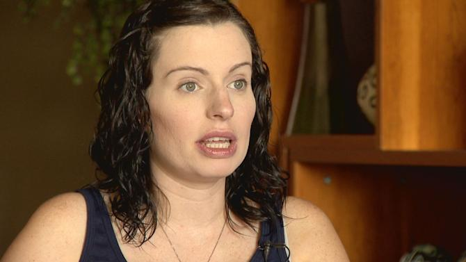 In this Aug. 25, 2015 photo provided by KUSA-TV, expectant mother Amber McCullough is pictured during an interview with Colorado's KUSA-TV, a day before she was to give birth to conjoined twins in Aurora, Colo. McCullough, of Hastings, Minn., was scheduled to deliver twin girls at the Colorado Fetal Care Center at Children's Hospital Colorado by C-section on Wednesday, Aug. 26, 2015. Hospital officials said Wednesday they had no update on the surgery. (KUSA-TV Photo via AP)