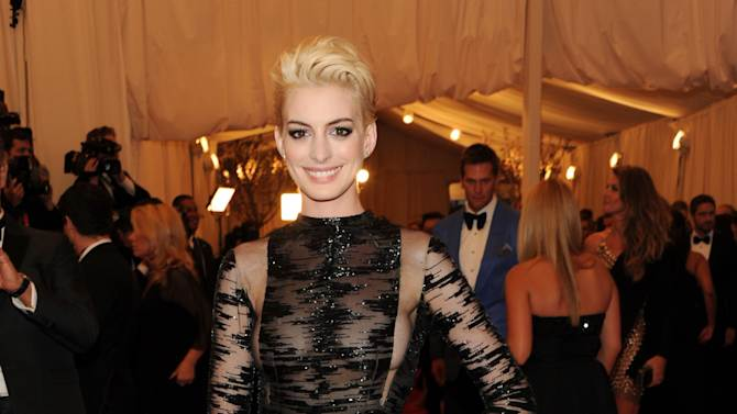 """Actress Anne Hathaway attends The Metropolitan Museum of Art's Costume Institute benefit celebrating """"PUNK: Chaos to Couture"""" on Monday, May 6, 2013 in New York. (Photo by Evan Agostini/Invision/AP)"""