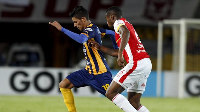 Balanta of Colombia's Santa Fe fights for the ball with Nunez of Paraguay's Esportivo Luqueno during their Copa Sudamericana soccer match in Bogota