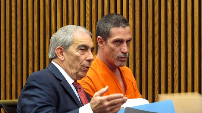Bobby Hernandez, right, listens to defense attorney Ralph DeFranco in Cuyahoga County Common Pleas Court before pleading not guilty to kidnapping and other charges on Tuesday, Dec. 1, 2015 in Cleveland. Authorities allege Hernandez took his 5-year-old son from an Alabama home in 2002 and created a life for them in Ohio under new identities, a ruse discovered through discrepancies with the boy's Social Security number as he began the college application process. (AP Photo/Kantele Franko)