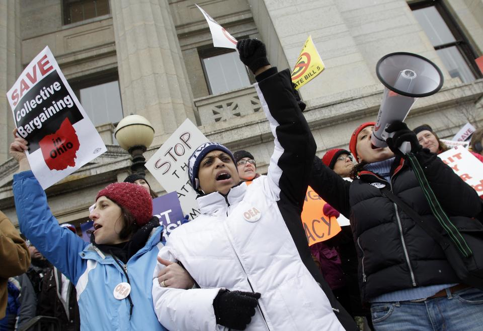 Protesters cheer during a protest against Senate Bill 5 outside the Ohio Statehouse, Tuesday, Feb. 22, 2011, in Columbus, Ohio. (AP Photo/Jay LaPrete)