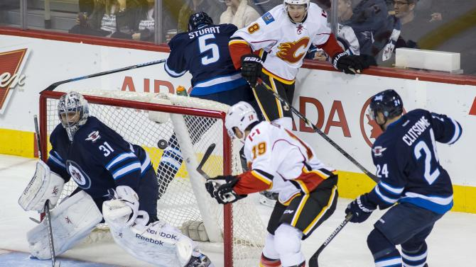 Jets get goals from 4 players, beat Calgary 4-1