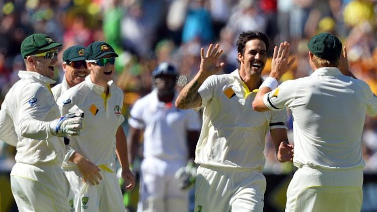 Australian paceman Mitchell Johnson (2nd R) celebrates the wicket of England's Alastair Cook during day two of the second Ashes Test cricket match in Adelaide on December 6, 2013