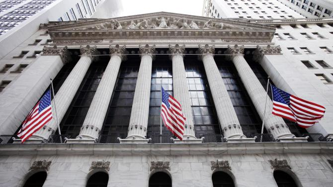FILE - In this Feb. 10, 2011, file photo, American flags fly in front of the New York Stock Exchange, in New York. Stock markets fell Monday, Sept. 22, 2014, ahead of a preliminary manufacturing survey from China that might show renewed weakness in the world's second-largest economy. (AP Photo/Mark Lennihan, File)