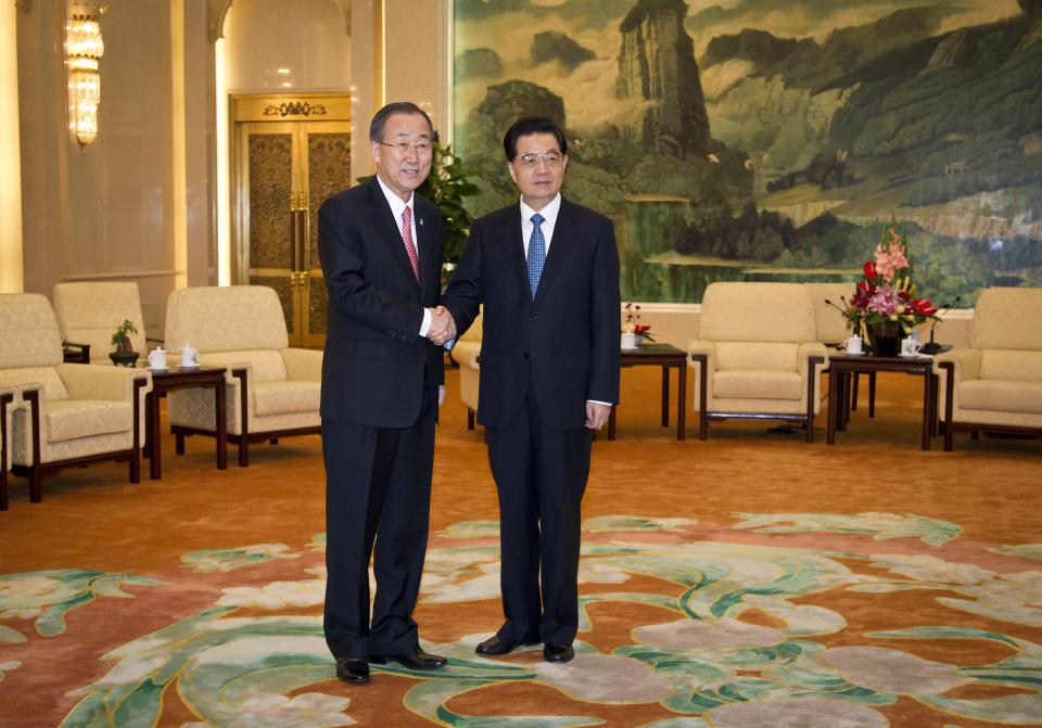 U.N. Secretary-General Ban Ki-moon, left, shakes hands with Chinese President Hu Jintao before a meeting at the Great Hall of the People in Beijing, China Wednesday, July 18, 2012. (AP Photo/Andy Wong, Pool)