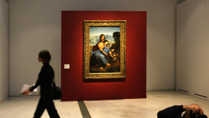 "A woman walk past ""La Vierge, l'Enfant Jesus et Sainte Anne"" by Leonard de Vinci in the Louvre Museum in Lens, northern France, Monday, Dec. 3, 2012. The museum in Lens, to open the 12 Dec, is part of a strategy to spread art beyond the traditional bastions of culture in Paris. (AP Photo/Michel Spingler)"