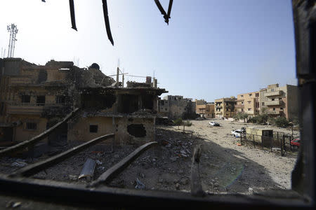 Homes are seen damaged after clashes between members of Libyan pro-government forces and Shura Council of Libyan Revolutionaries in Benghazi