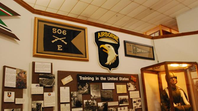 """The flag of Easy Company, 506th Parachute Infantry Regiment, who were made famous as the """"Band of Brothers"""" in World War II, is seen on a wall on June 27, 2013, inside the museum at Fort Campbell, Ky. The 101st Airborne Division is trying to save their storied 506th Infantry Regiment from being eliminated under the Army's massive restructuring. (AP Photo/Kristin M. Hall)"""