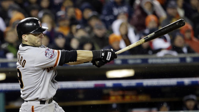 San Francisco Giants' Marco Scutaro hits an RBI single during the 10th inning of Game 4 of baseball's World Series against the Detroit Tigers Sunday, Oct. 28, 2012, in Detroit. (AP Photo/David J. Phillip)