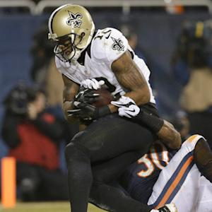 New Orleans Saints quarterback Drew Brees throws a 9-yard touchdown pass to wide receiver Marques Colston