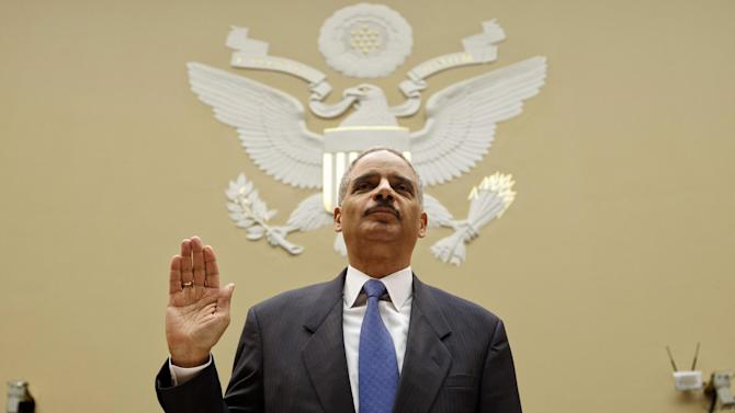 """Attorney General Eric Holder is sworn in on Capitol Hill in Washington, Thursday, Feb. 2, 2012, prior to testifying before the House Oversight and Government Reform Committee hearing entitled, """"Fast & Furious: Management Failures at the Department of Justice"""".   (AP Photo/J. Scott Applewhite)"""