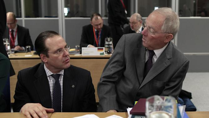Sweden's Finance Minister Anders Borg, left, speaks to Germany's Finance Minister Wolfgang Schauble before the Informal Meeting of ECOFIN Ministers in Dublin Castle, Ireland, Saturday, April 13, 2013. (AP Photo/Peter Morrison)