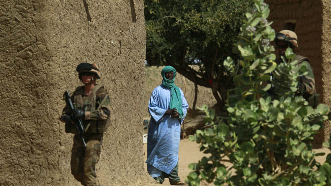 A French soldier secures the area where a suicide bomber attacked,  at the entrance of  Gao, northern Mali, Sunday  Feb. 10, 2013. It was the second time a suicide bomber targeted the Malian army checkpoint in three days.  (AP Photo/Jerome Delay)