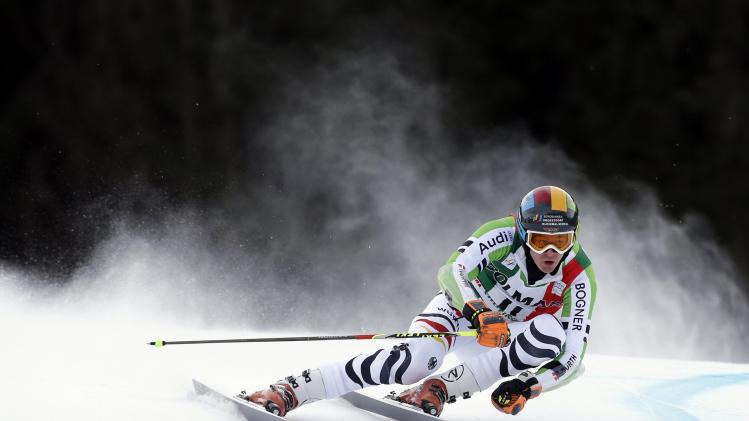 Luitz of Germany clears a gate during the first run in the men's World Cup giant slalom skiing race in Alta Badia