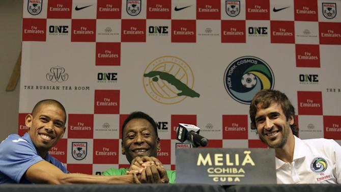 Cuba's soccer player Marquez, former Brazilian soccer star Pele and New York Cosmos player Raul join hands after a news conference in Havana