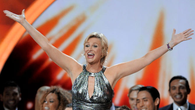Host Jane Lynch performs at the 63rd Primetime Emmy Awards on Sunday, Sept. 18, 2011 in Los Angeles. (AP Photo/Mark J. Terrill)