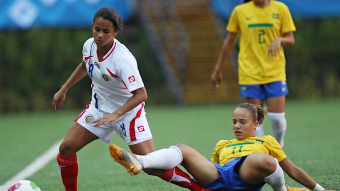 Brazil's Thais Guedes, right, fights for the ball with Costa Rica's Daniela Cruz during a women's soccer match at the Pan American Games in Guadalajara, Mexico, Thursday, Oct. 20, 2011. (AP Photo/Juan Karita)