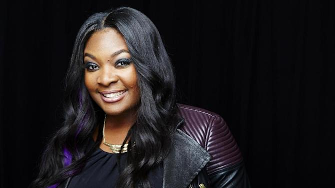"""This May 20, 2013 photo shows Candice Glover posing for a portrait in New York. Glover is the latest winner on the singing competition series, """"American Idol."""" (Photo by Dan Hallman/Invision/AP)"""