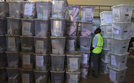 An official from the Independent Electoral and Boundaries Commission (IEBC) inspects ballot boxes at Kasarani gymnasium in Kenya's capital Nairobi