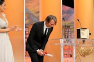 "Danish actor Mads Mikkelsen bows to thank the audience after being awarded with the Best Actor award during the closing ceremony of the 65th Cannes film festival in Cannes. Mikkelsen, 46, is best known to international audiences for his role as James Bond's nemesis Le Chiffre in 2006's ""Casino Royale"" and is now starring in the Scandinavian blockbuster ""A Royal Affair"""