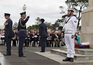 Prince Charles (2nd L) salutes after laying a wreath at the Auckland War Memorial on November 11. The prince will celebrate his 64th birthday in the capital on Wednesday at a gathering at Government House with people who were also born on November 14