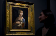 Francesca Sidhu views 'Cecilia Gallerani, The Lady with an Ermine' by Leonardo da Vinci, part of the ˜Leonardo da Vinci: Painter at the Court of Milan' exhibition shown at the National Portrait Gallery in London Monday, Nov. 7, 2011. (AP Photo/Jonathan Short)