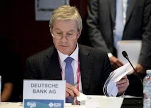 Fitschen, Co-Chief Executive Officer of Deutsche Bank, reads notes during the Joint G20 and B20 Infrastructure Roundtable meeting as part of the G20 Finance Ministers and Central Bank Governors meeting in Sydney