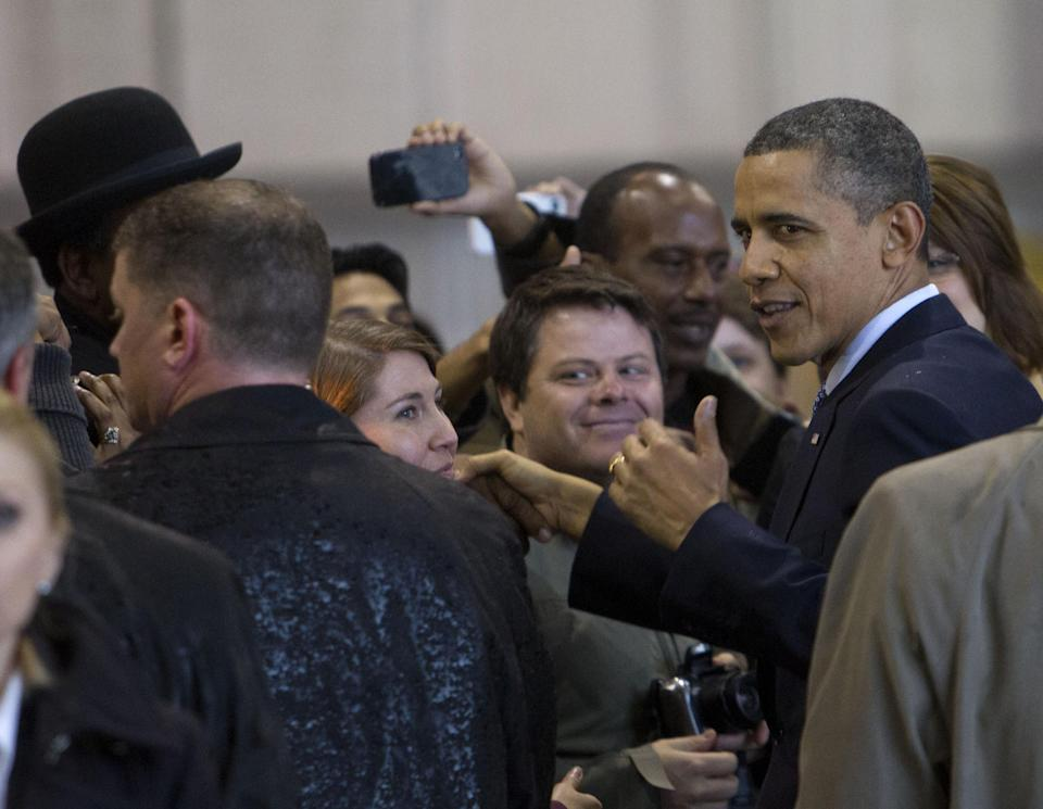 President Barack Obama greets guests as he arrives at Ellington Field Friday, March 9, 2012 in Houston,Texas. (AP Photo/Bob Levey)