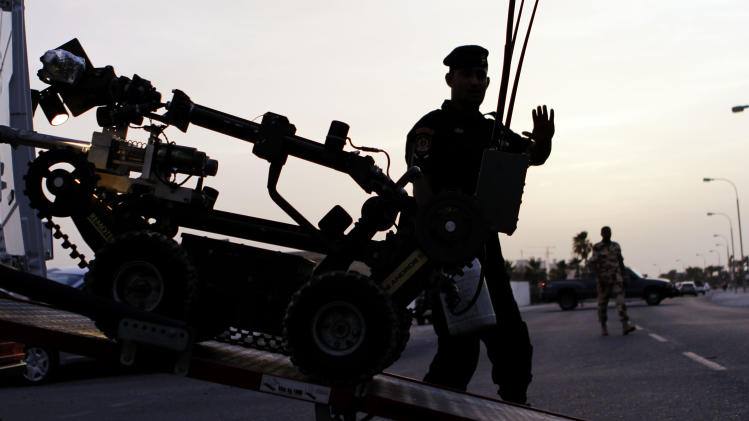 "Bahraini police unload a robot to investigate a suspicious object, not pictured, Sunday, May 6, 2012, in the northwestern village of Saar, Bahrain. The object was determined to be harmless. Also on Sunday, a couple hundred people gathered outside prominent jailed human rights activist Nabeel Rajab's home, protesting his arrest Saturday night on, according to an Interior Ministry statement, ""suspicion of committing several punishable crimes."" (AP Photo/Hasan Jamali)"
