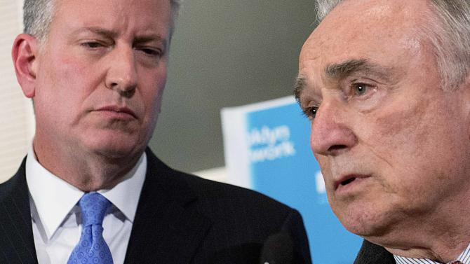 New York Police Commissioner Bratton speaks as New York Mayor De Blasio looks on at a news conference at Woodhull Medical Center in Brooklyn, New York
